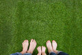 Family legs standing together on green grass Royalty Free Stock Photo