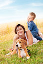 Family leisure with favorite pet mother and son have a nice moment on the walk his Stock Image