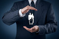 Family life insurance and policy services supporting families concepts businessman with protective gesture Stock Photos