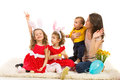 Family looking away and one girl showing victory of mother kids in left part of image while of girls sign hand gesture Royalty Free Stock Photos