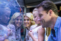 Family looking at starfish in a tank Royalty Free Stock Photo