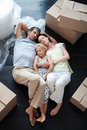 Family lying on floor after buying a house Royalty Free Stock Image