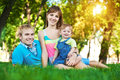 Family are lying on the grass Stock Photography