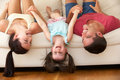 Family Lying Upside Down On Sofa With Daughter Royalty Free Stock Photo