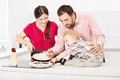 Family makes pancakes in the kitchen happy Stock Images