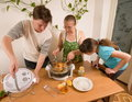 The family makes a supper. Royalty Free Stock Photos