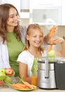 Family making fresh juice Royalty Free Stock Photo