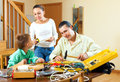 The family is making something with the working tools in living room Royalty Free Stock Photo