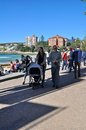 Family at manly a enjoying their time walking along beach this beach is located in the northern beach of sydney Stock Photography