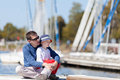 Family at a marina dock caucasian father and his son sitting together Royalty Free Stock Photography
