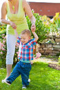 Family mother and child in garden playing on a beautiful summer day Stock Photography