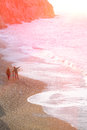 Family of Mother Father baby walking on Beach soft Tone Royalty Free Stock Photo