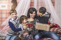 Family mother father and children give each other gifts in your Royalty Free Stock Photo
