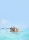 Family mother with kids swimming in a tropical ocean children Royalty Free Stock Photography
