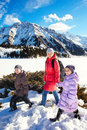 Family (mother with two children) take a walk on winter mountain Stock Images