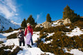 Family (mother with two children) take a walk on winter mountain Stock Photography