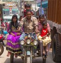 stock image of  Family on a Motorized Cart in India