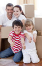 Family moving house with boxes and thumbs up Royalty Free Stock Image