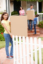 Family moving into new house Royalty Free Stock Image
