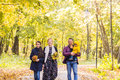 Family, nature, autumn and people concept - Portrait of Happy mother, father, son and daughter in fall Royalty Free Stock Photo
