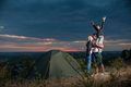 Family near camp tent on the hill Royalty Free Stock Photo