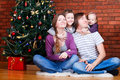 Family near Christmas tree Stock Photography