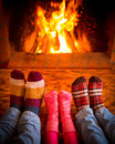Family near fireplace Royalty Free Stock Photo