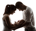 Family with newborn baby parents silhouette over white background child birth concept Stock Photos