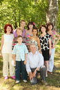 Family of nine people pose at park Royalty Free Stock Photography