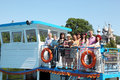 Family of nine people walking on pleasure craft Royalty Free Stock Images
