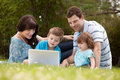 Family outdoors with computer happy together Royalty Free Stock Photo