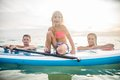 Family with paddle board Royalty Free Stock Photo