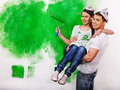Family paint wall at home happy Stock Photo