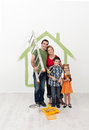 Family painting their home - with the kids helping Royalty Free Stock Photo