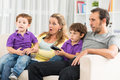 Family pastime close up image of a spending their evening together watching tv at home Royalty Free Stock Photos