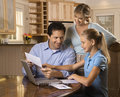 Family paying bills on computer. Royalty Free Stock Photo