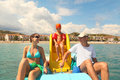 Family on pedal boat with slide in sea Royalty Free Stock Image
