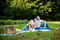 Family picnic having on a park meadow Royalty Free Stock Photography