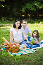 Family picnic at a meadow having on park daughter holds watermelon Royalty Free Stock Photo