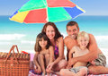 Family picnicking under a sol umbrella Royalty Free Stock Photography