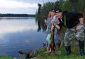 Family pike fishing father with daughter after Stock Photo