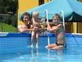 Family play in collapsible pool Royalty Free Stock Image