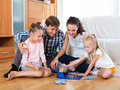 Family play at lotto game Royalty Free Stock Photo