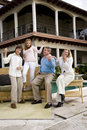 Family playing air guitar on patio Royalty Free Stock Photo