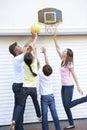 Family Playing Basketball Outside Garage Royalty Free Stock Photo
