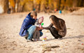 Family playing on beach with daughter at autumn young Stock Image