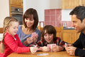 Family Playing Cards In Kitchen Royalty Free Stock Photo