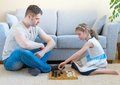 Family playing checkers. Royalty Free Stock Photo