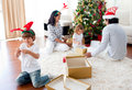 Family playing with Christmas gifts at home Royalty Free Stock Photo