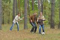 Family is playing football happy in forest Royalty Free Stock Images